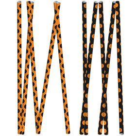 Papirsugerør, sorte og oransje prikker