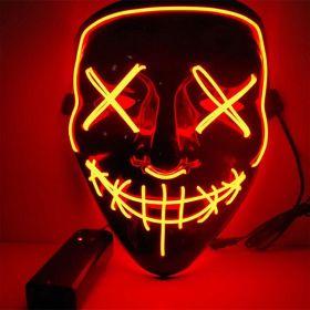 Oransje ledmaske med kryss over øynene og sting over munnen. Maskens bakgrunn er sort så det eneste som lyser opp er de mange lysglimtene på masken i oransje