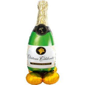 """Selvstående champagneflaske som ballongpynt. flasken er i fargen grønn med hvit ettikett slik som en ekte champagneflaske skal være. toppen på flasken er i gull og klar til å """"poppes"""". Under flasken er det fire små gullfargede ballonger som holder flasken"""