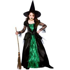 Bilde av jente i Smaragd heks kostyme. Sort kjole med grønne detaljer med spindelvevmønster og sort heksehatt.